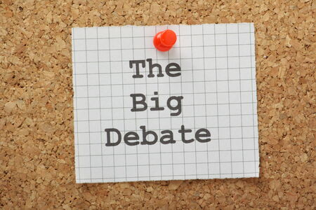The phrase The Big Debate typed on a piece of graph paper and pinned to a cork notice board Stock Photo
