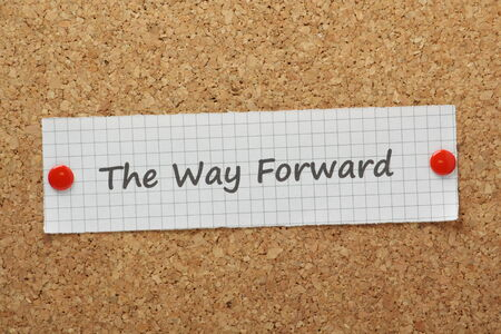 The Way Forward typed on a piece of graph paper and pinned to a cork notice board photo