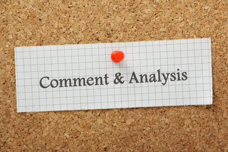 critique: The words Comment and Analysis typed on a piece of graph paper and pinned to a cork notice board Stock Photo