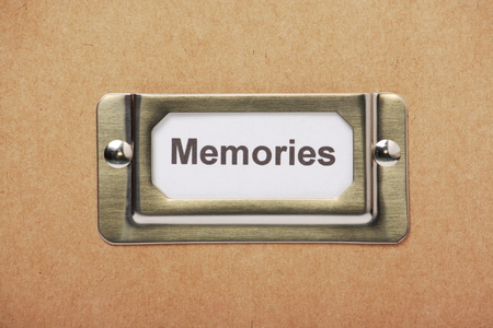 recall: A label for Memories in a metal holder on the outside of a cardboard box