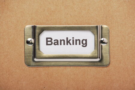 filing cabinet: The word Banking on a label in a metal holder on a cardboard storage drawer Stock Photo