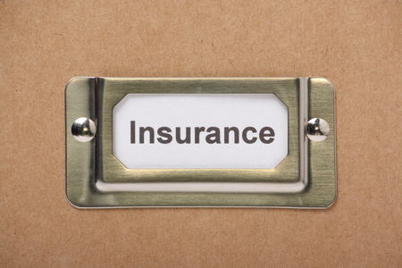 claims: Insurance Drawer Label on a cardboard drawer or storage box