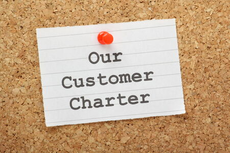 cork board: Our Customer Charter reminder pinned to a cork notice board  A charter enables businesses to set out their core values and commitments on delivery and service to the customer