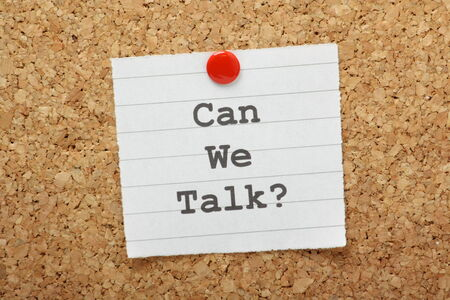 discourse: The phrase Can We Talk typed on a paper note and pinned to a cork notice board