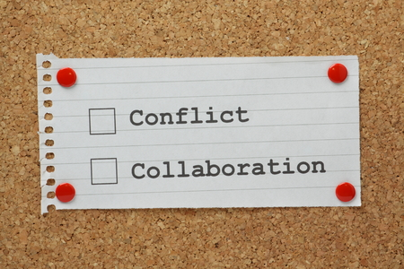 co cork: Conflict or Collaboration tick boxes on a cork notice board