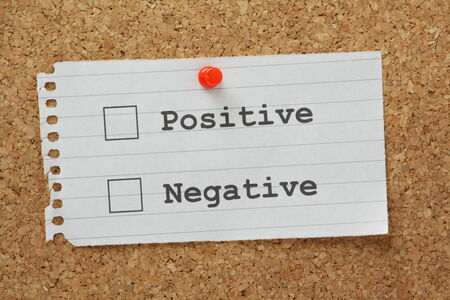 Positive or Negative tick boxes on a cork notice board
