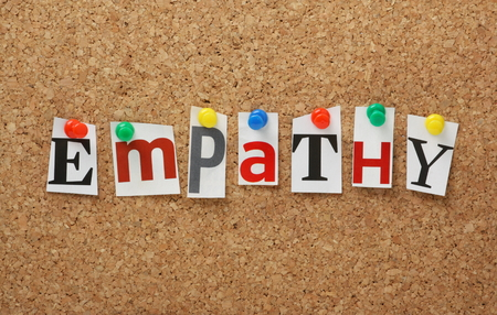 The word Empathy in cut out magazine letters pinned to a cork notice board  Empathy is the experience of understanding another person s condition from their perspective