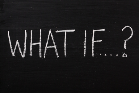 what if: The question What If written on a used blackboard