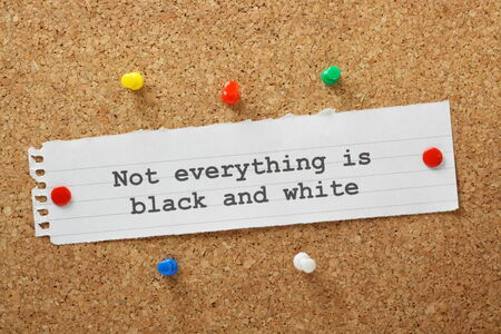 open minded: The phrase Not Everything is Black and White typed on a paper note and pinned to a cork notice board