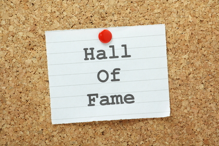 fame: The phrase Hall of Fame typed on a piece of paper and pinned to a cork notice board