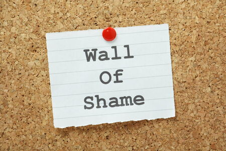 infamous: The phrase Wall of Shame typed on a piece of paper and pinned to a cork notice board