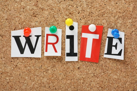 writers block: The word Write in cut out magazine letters pinned to a cork notice board