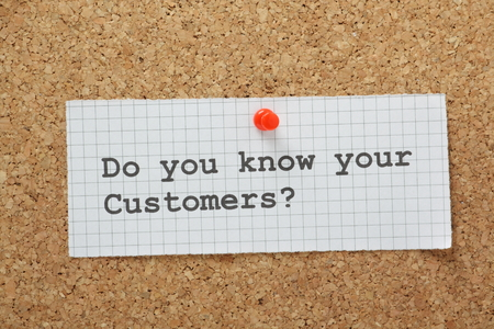 The phrase Do You Know Your Customers typed on a piece of graph paper and pinned to a cork notice board