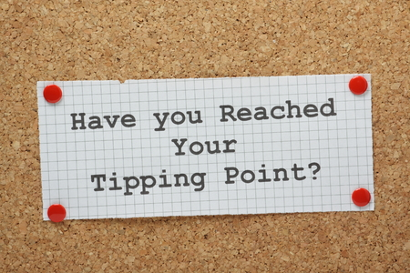 tipping: The phrase Have You Reached Your Tipping Point typed on a piece of graph paper and pinned to a cork notice board