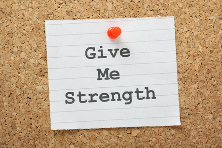 The phrase Give Me Strength typed on a piece of paper and pinned to a cork notice board