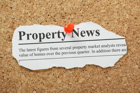 property management: A fake Property News headline torn out and pinned to a cork notice board Stock Photo