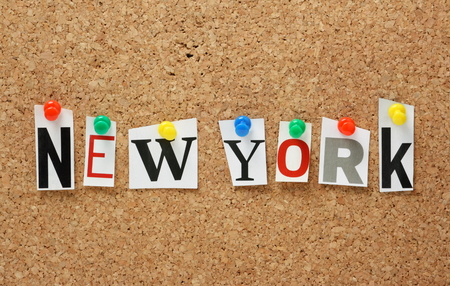 The name New York in cut out magazine letters pinned to a cork notice board photo