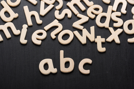 grammar: Wooden letters arranged to spell abc for the alphabet on a blackboard