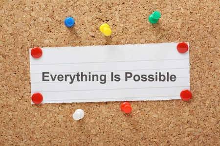 mantra: The phrase Everything is Possible typed on a paper note and pinned to a cork notice board Stock Photo
