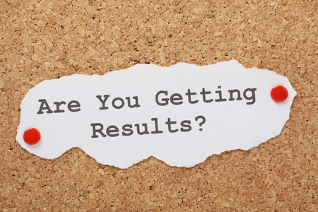 The question Are You Getting Results  typed on a piece of paper and pinned to a cork notice board Standard-Bild