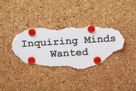 inquiring: The phrase Inquiring Minds Wanted typed on paper and pinned to a cork notice board