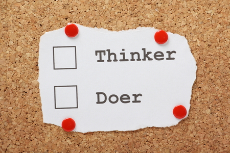 Tick Boxes for Thinker or Doer on a piece of paper pinned to a cork notice board Stock Photo