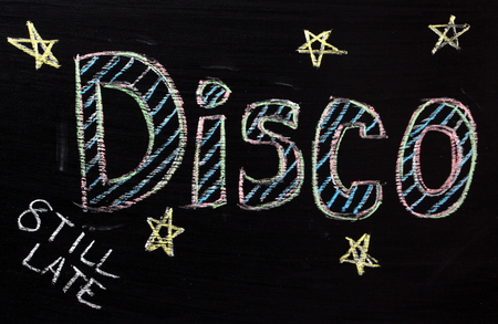 advertised: Disco advertised on a blackboard from eight until late Stock Photo