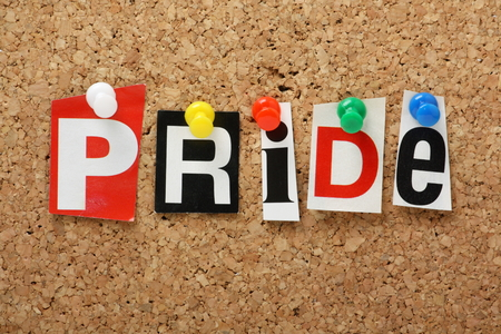seven deadly sins: The word Pride, one of the seven deadly sins in cut out magazine letters pinned to a cork notice board