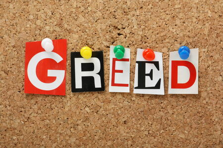 seven deadly sins: The word Greed, one of the seven deadly sins in cut out magazine letters pinned to a cork notice board