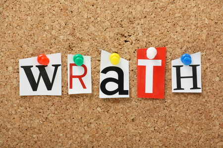 The word Wrath, one of the seven deadly sins in cut out magazine letters pinned to a cork notice board Stock Photo