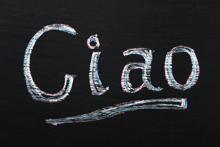 ciao: Ciao the Italian word for hello or goodbye on a blackboard Stock Photo