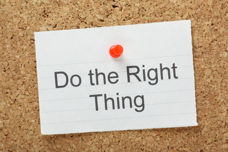 phrase: The phrase Do The Right Thing typed on a piece of paper and pinned to a cork notice board