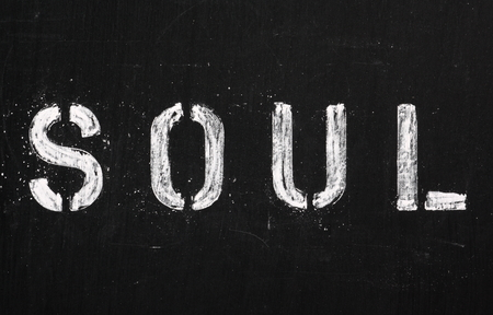 emerged: The word SOUL in stencil letters on a blackboard Soul music emerged in the twentieth century from cities including Detroit and Chicago in the USA Stock Photo