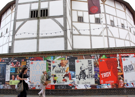 London - Aug 17  People passing posters advertising plays at The Globe Theater on 21st August 2014  The theater, a reconstruction of Shakespeare s original globe, opened for performances in 1997