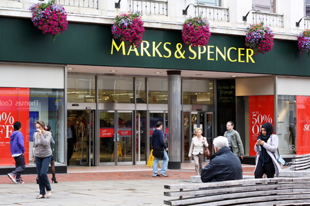 spencer: Reading, England - August 28th, 2014: People passing by the Marks and Spencer store in Reading, England. Founded in 1884, M&S has grown from a single market stall into an international retailer.