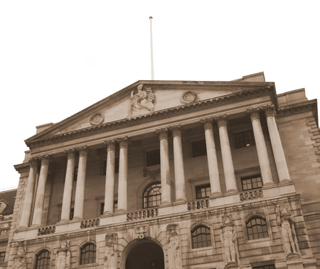 quantitative: The exterior of the Bank of England in Threadneedle Street, London. A sepia tone has been added to the image for a vintage effect.