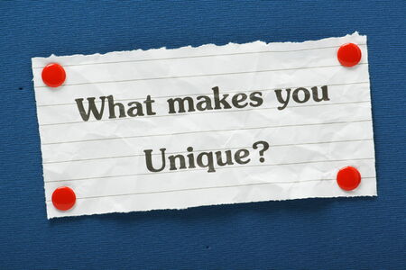 skillset: The question What Makes You Unique? typed on a piece of lined paper and pinned to a blue notice board Stock Photo