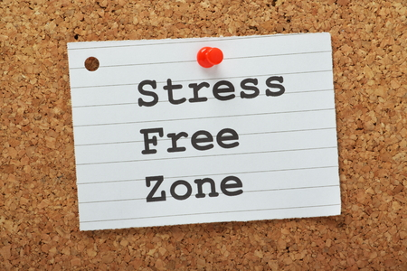 The phrase Stress Free Zone typed on a piece of lined paper and pinned to a cork notice board as a reminder