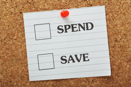 frugal: Tick Boxes for the choices to Spend or Save on a piece of lined paper pinned to a cork notice board