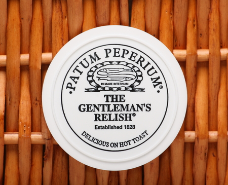 London, England - Sept 25th, 2014: A pot of Patum Peperium, The Gentlemans Relish. Invented by Englishman John Osborn in 1828 the paste is mainly spiced anchovy and butter with herbs and spices