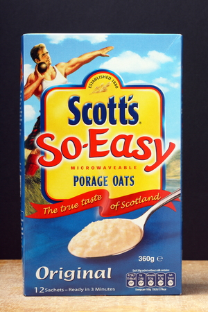 typically scottish: London, England - October 16th, 2014: A box of Scotts Microwaveable Porridge Oats. The company was started by A & R Scott in 1880 in Glasgow, Scotland Editorial