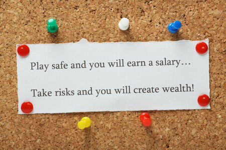 taking risks: Playing it safe versus taking risks concept for entrepreneurs or people in work typed on a piece of paper and pinned to a cork notice board Stock Photo