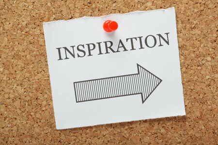 writers block: Inspiration This Way reminder pinned to a cork notice board