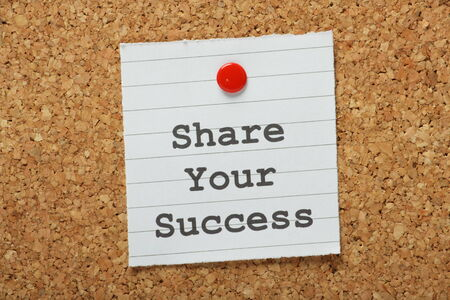 best practices: The phrase Share Your Success typed on a paper note and pinned to a cork notice board