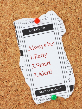 be alert: Latest jobs newspaper clipping pinned to a notice board with advice for job interviewees to be Early,Smart and Alert