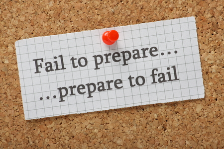 A reminder that if you fail to prepare you are preparing to fail typed on a piece of graph paper pinned to a cork notice board Standard-Bild