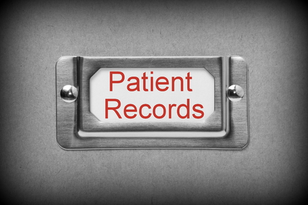 patient's history: A black and white image of a metal drawer label holder with a white card and the title Patient Records added in red text Stock Photo