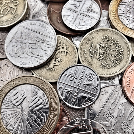 pence: Close up of British Coins including bronze and silver, pound coins, pence and pennies. Creative filters and textures have been applied for effect Stock Photo