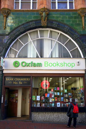 bookshop: Reading, England - January 29, 2015: Person looking at the window display of the Oxfam Bookshop in Reading, England. The original Oxford Committee for Famine Relief was set up in 1942