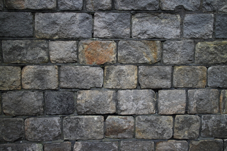 long lasting: Close up of the grey stone wall of an ancient building Stock Photo